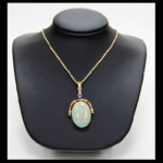 14KY Opal, Diamond and Tanzinite Pendant